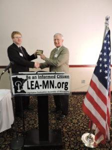 John Augustine presents award to 2016 Senate honoree Bruce Anderson